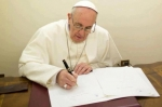 Pope-Francis-writing-740x493-OS.jpg